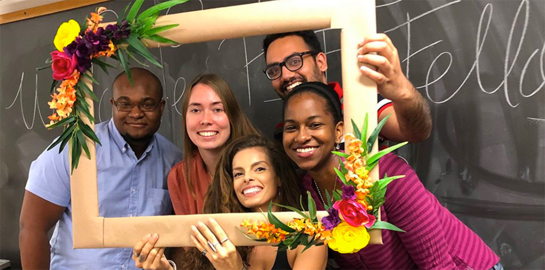 PIF Fellows smiling and holding picture frame